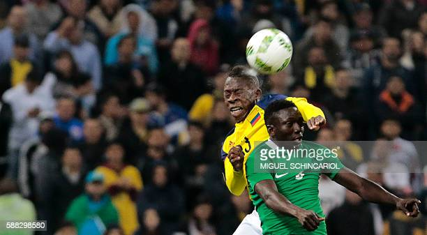 TOPSHOT Helibelton Palacios of Colombia vies for the ball with Oghenekaro Etebo of Nigeria during their Rio 2016 Olympic Games First Round Group B...