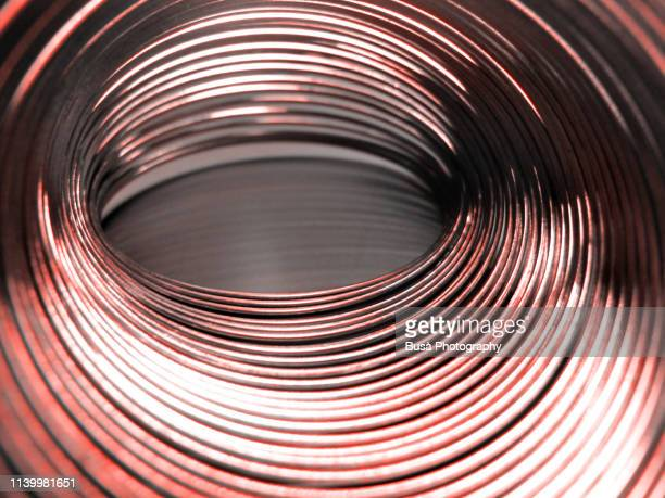 helical coil spring close-up (color manipulation with living coral pantone, color of the year 2019) - 2010 2019 stock pictures, royalty-free photos & images