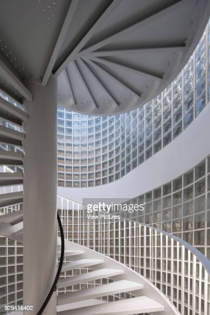 Helical staircase and glass brick facade Housing Building Quai Henri IV Paris France Architect LIN 2015