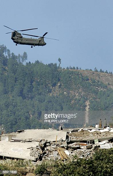 US helicoper flies over the earthquakehit area of Balakot in Pakistan's North West Frontier province 13 October 2005 A powerful aftershock rattled...
