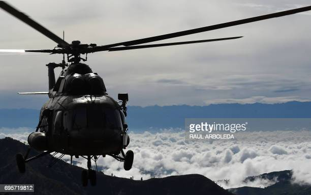 A helicoper of the Colombian army overflies a FARC demobilization zone before a ceremony as part of the peace process in Buenos Aires Cauca...