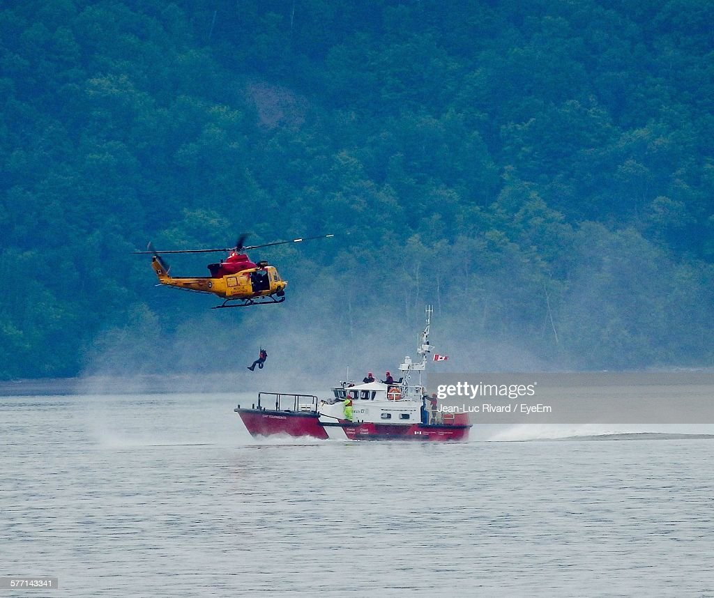 Helicopter Above Coast Guard Boat : Stock Photo