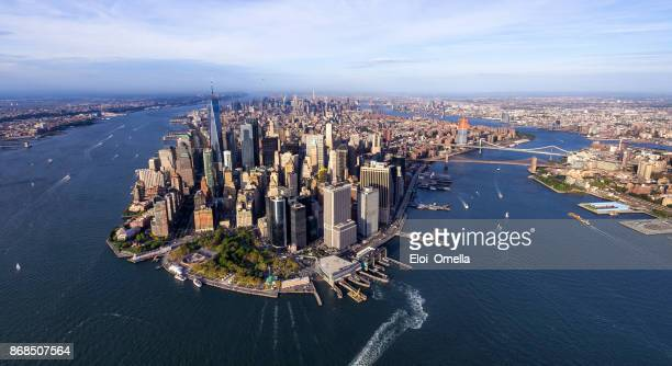 helicopter aerial view of manhattan - lower manhattan stock photos and pictures
