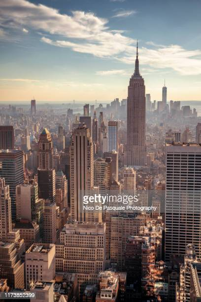 helicopter aerial view of new york city - vertical stock pictures, royalty-free photos & images