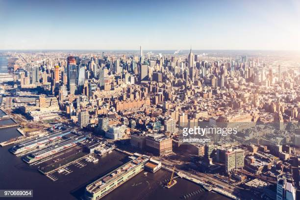 helicopter aerial view of new york city skyline and harbor - hudson river stock pictures, royalty-free photos & images