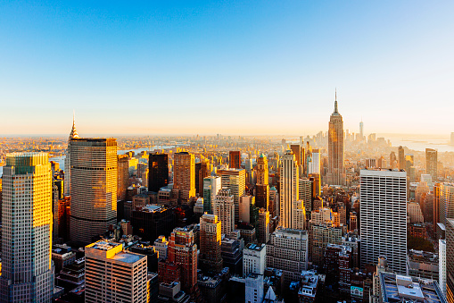 Helicopter aerial view of New York City skyline during sunset, NY, United States - gettyimageskorea