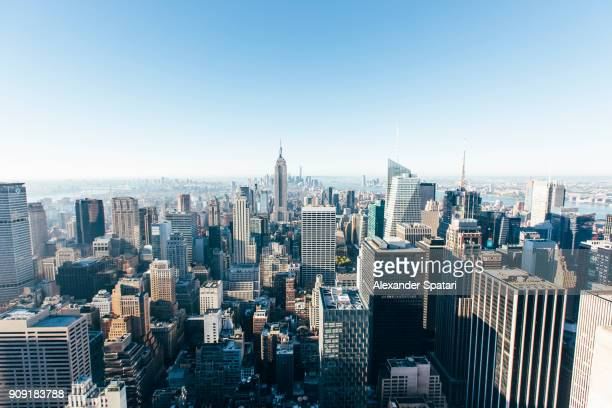 helicopter aerial view of new york city skyline, ny, united states - new york stock-fotos und bilder