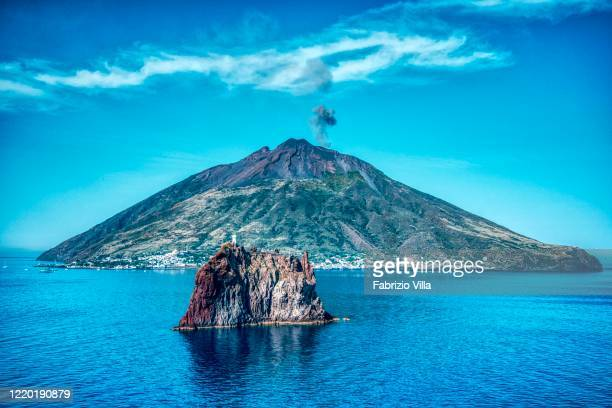 Helicopter aerial view of the island of Stromboli and in the foreground Strombolicchio on June 06 2019 in Stromboli Italy