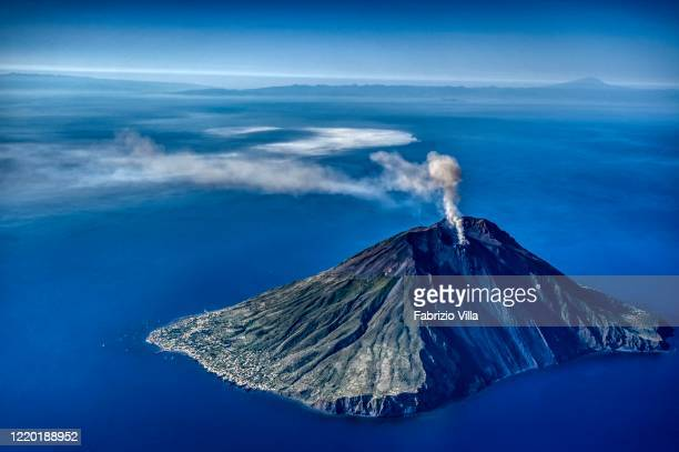 Helicopter aerial view of the island of Stromboli during a gas emission and explosions on June 06 2019 in Stromboli Italy