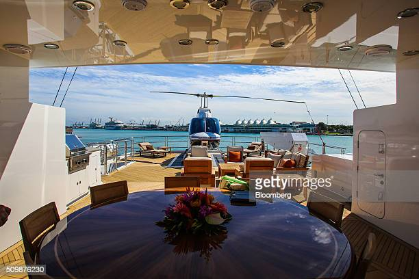 A helicopter and furniture sit on the deck aboard the 193 feet long superyacht Skyfall during the Superyacht Miami boat show at Island Gardens Deep...