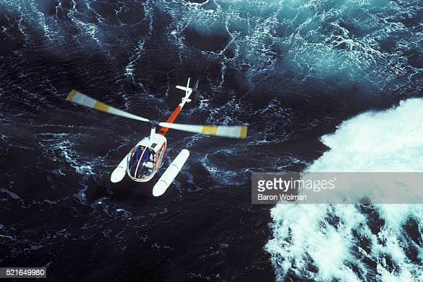 Helicopter and Surf, California, United States, circa 1970s.
