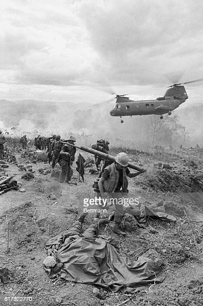 A helicopter arrives at a hill near Khe Sanh to pick up those soldiers killed and wounded when a US fighter plane accidentally fired upon a US...