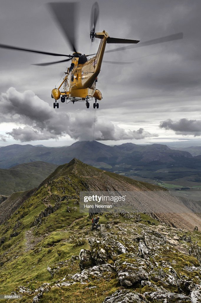 Helicopter assisting an injured climber. : Stock-Foto