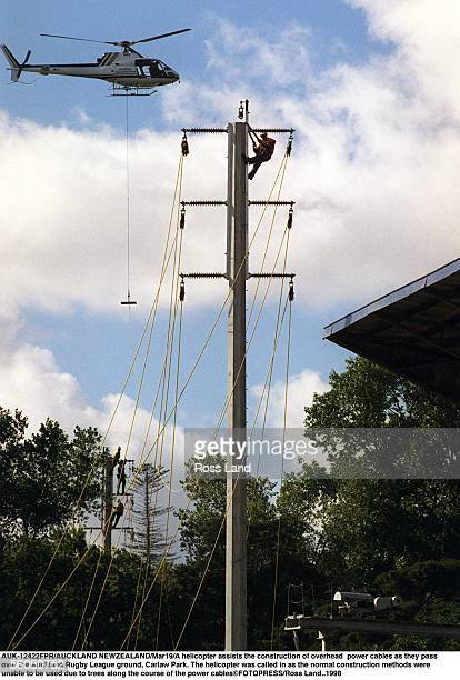 A helicopter assists the construction of overhead power cables as they pass rover the Auckland Rugby League ground Carlaw Park The helicopter was...