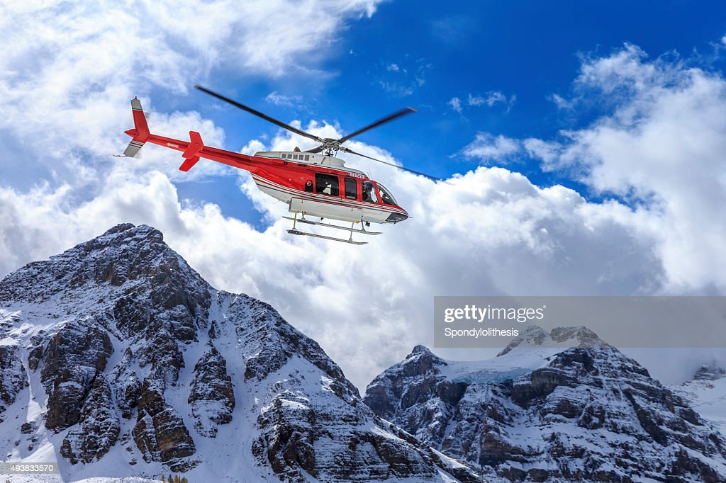 Helicopter at Assiniboine Lodge and Magog Lake : Stock Photo