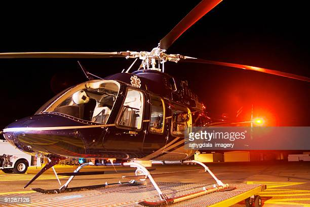 helicopter at night on tarmac - medevac stock photos and pictures