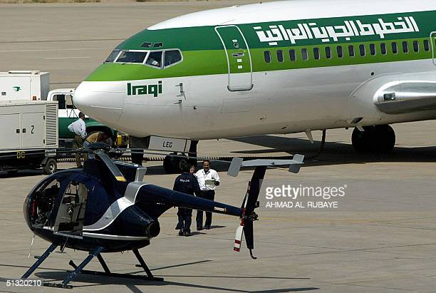 A helicopter belonging to the US security firm Blackwater is seen parked near Iraqi airway plane preparing to take off at Baghdad International...