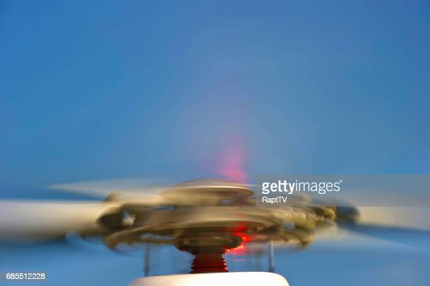 helicopter blades spinning at high speed. - helicopter rotors stock photos and pictures