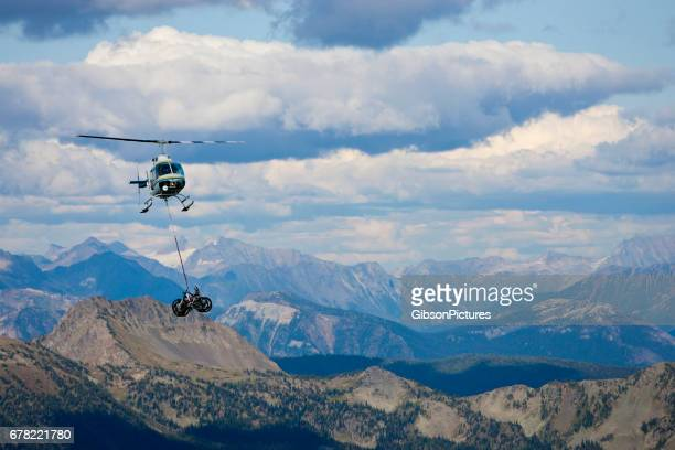 A helicopter carries a load of mountain bikes to the top of the trail in British Columbia, Canada.
