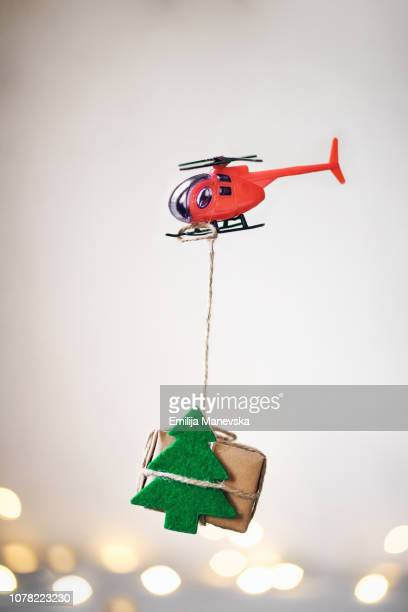 helicopter carrying a christmas gift - オクトコプター ストックフォトと画像