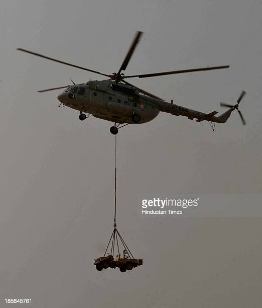 Helicopter carrying an armored vehicle for the special forces during the IndiaRussia Joint Exercise Indra2013 at Mahajan Firing Range near Bikaner on...