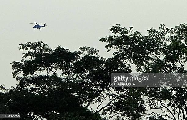 Helicopter carrying former FARC hostages overflies Villavicencio, Colombia on April 2 after they were liberated. Colombia's leftist Revolutionary...