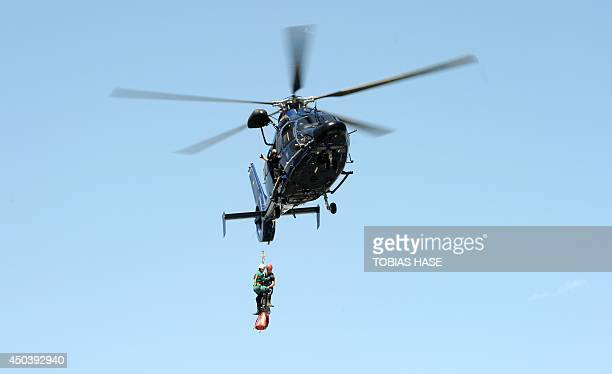 A helicopter carrying helpers from Switzerland specialised in cave rescue arrives at the Untersberg near Marktschellenberg southern Germany on June...