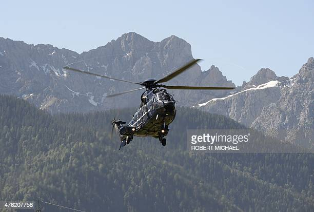 Helicopter carrying the German chancellor arrives in Kruen near Garmisch-Partenkirchen on June 7, 2015 prior to the start of a G7 summit. Germany...