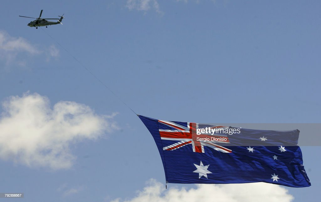 A helicopter carrying the giant Australian flag fly over Sydney Harbour during the Australia Day celebrations on January 26, 2008 in Sydney, Australia.