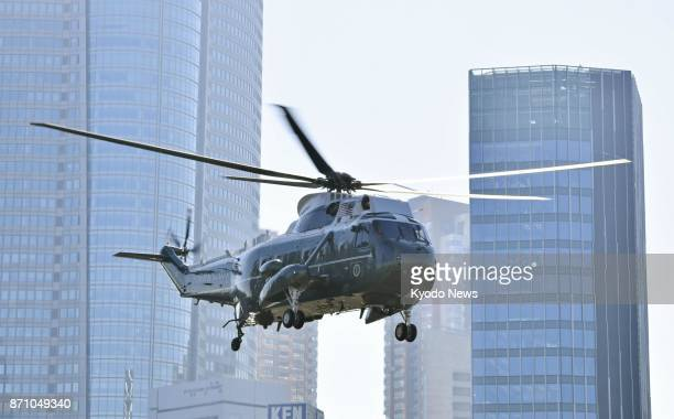 A helicopter carrying US President Donald Trump flies off to Yokota Air Base in Tokyo on Nov 7 for his departure to South Korea ==Kyodo