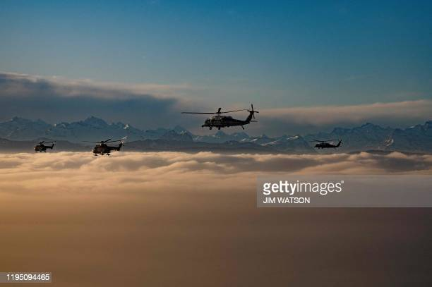 TOPSHOT A helicopter carrying US President Donald Trump flies over the Swiss Alps on his way to Davos Switzerland on January 21 for the World...