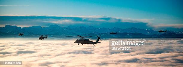 A helicopter carrying US President Donald Trump flies over the Swiss Alps on his way to Davos Switzerland on January 21 for the World Economic Forum