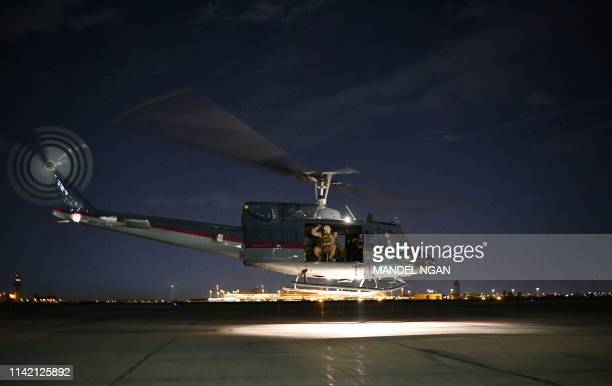 A helicopter carrying US Secretary of State Mike Pompeo takes off from Baghdad International Airport in Baghdad on May 7 2019 Pompeo is scheduled to...
