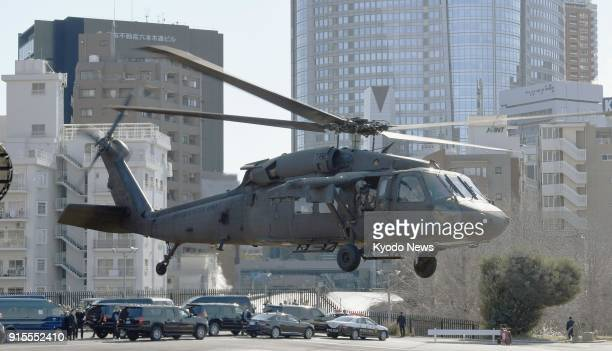A helicopter carrying US Vice President Mike Pence takes off from Akasaka Press Center a facility of the US military in Tokyo's Roppongi district for...