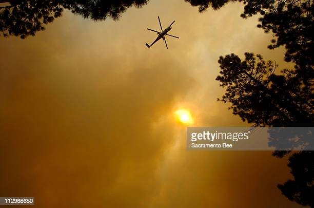 Helicopter circles above a forest fire in South Lake Tahoe, California, June 26, 2007.