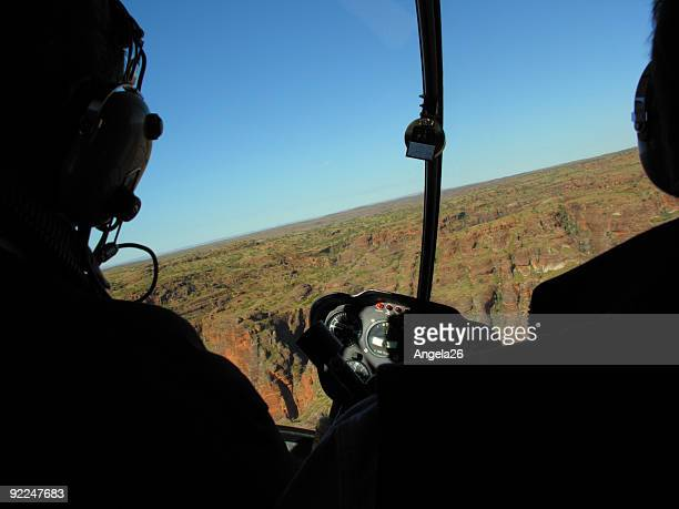 helicopter cockpit over the outback - helicopter stock pictures, royalty-free photos & images