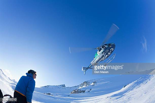 Helicopter dropping off skiers