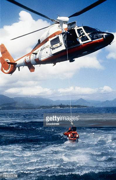 helicopter during rescue at sea - redding sporten stockfoto's en -beelden