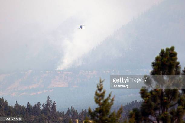 Helicopter flies above a wildfire burning near Lytton, British Columbia, Canada, on Friday, July 2, 2021. Canadian Prime Minister Justin Trudeau...