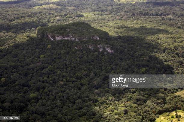 A helicopter flies above Chiribiquete National Park in this aerial photograph taken above San Jose del Guaviare Colombia on Monday July 2 2018 The...