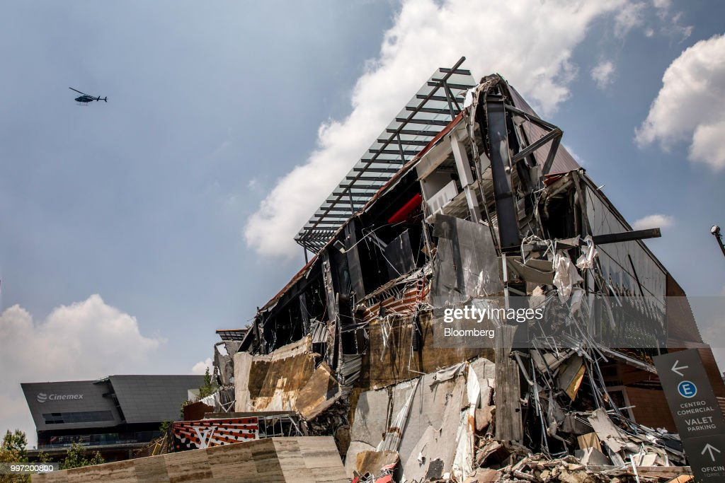 A helicopter flies above the collapsed section of the Artz Pedregal shopping mall in Mexico City, Mexico, on Thursday, July 12, 2018. A section of the high-end fashionmallinaugurated a mere three months ago collapsed Thursday afternoon in Mexico City. Photographer: Alejandro Cegarra/Bloomberg via Getty Images