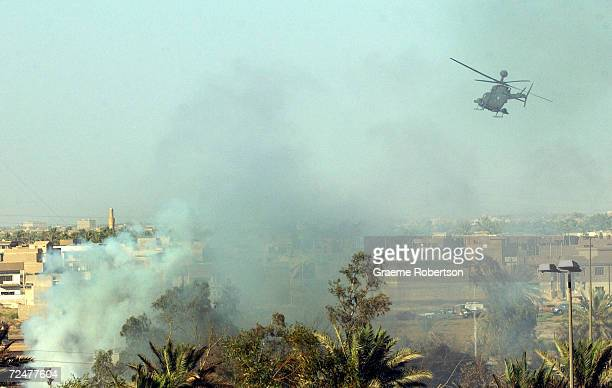 A helicopter flies above the destroyed UN headquarters at the Canal hotel August 19 2003 in Baghdad Iraq A huge truck bomb ripped through the...