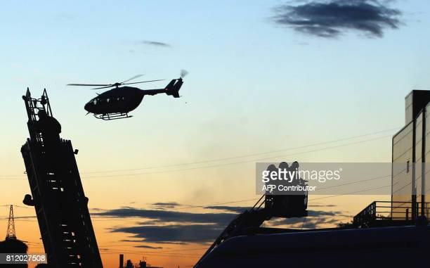 A helicopter flies above the Rio shopping mall following a fire in Moscow on July 10 2017 Ten people poisoned by smoke were hospitalised after a fire...