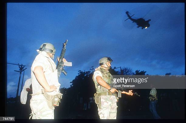 A helicopter flies above United Nations troops during a peacekeeping mission June 20 1993 in Mogadishu Somalia An estimated 350000 Somalis died due...