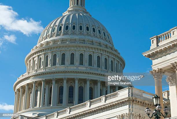A helicopter flies around the US Capitol Dome in support of an upcoming Architect of the Capitol construction project on Tuesday Nov 19 2013