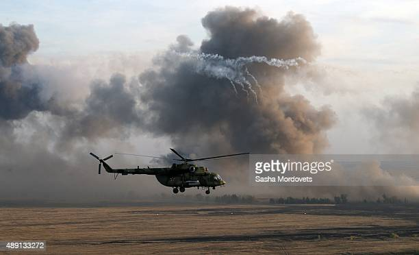 Helicopter flies during Russias large-scale Center-2015 military exercises at Donguzsky Range September 19, 2015 in Orenburg, Russia, The exercises,...