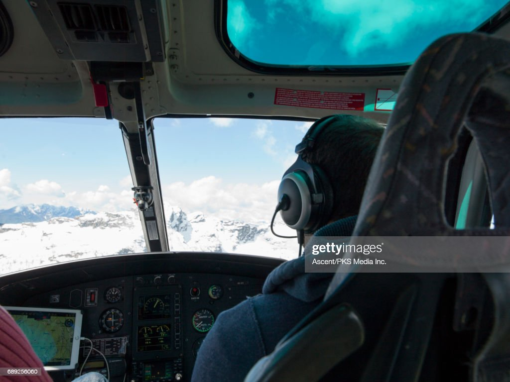 Helicopter flies over mountains, interior view : Stock Photo