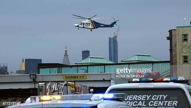 A helicopter flies over New Jersey Transit's rail station in Hoboken New Jersey September 29 2016 A commuter train crashed into a station in New...