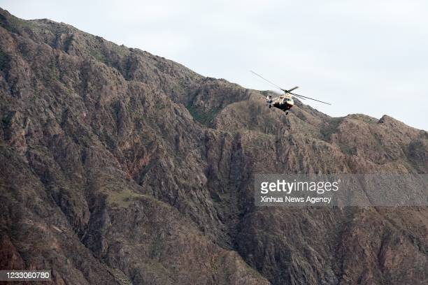 Helicopter flies over the accident site to search for survivors in Jingtai County of Baiyin City, northwest China's Gansu Province, May 23, 2021.The...