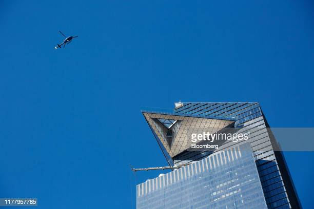 A helicopter flies over the Edge observation deck at 30 Hudson Yards in New York US on Thursday Oct 24 2019 Edge is scheduled to open to the public...